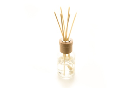 incense sticks: Beautiful fresh smelling incense sticks dipped in a fragrant liquid in a glass jar. Stock Photo