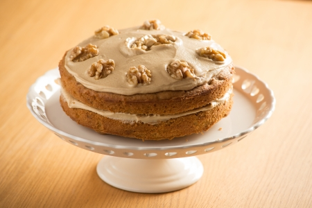 walnut cake: Beautifully presented Coffee and Walnut cake on a white cake stand