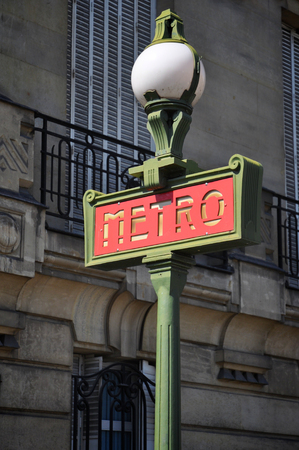 Bright Red Metro sign in Paris, France
