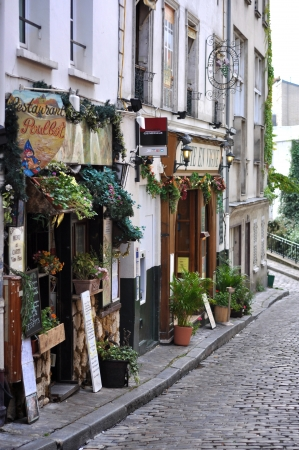 Quaint Parisian Street with flowers and signs in Paris France photo