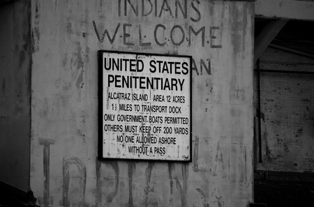 Graffitied United States Penitentiary Sign on the outside of Alcatraz Island