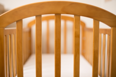 Close up of a Wooden Cot Frame for a new baby photo