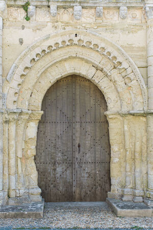 Very Old Large Wooden Church Door in Europe photo