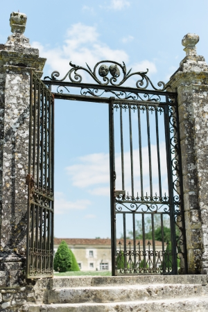 open garden gate: Large Wrought Iron Gate to provide protection to an old castle Editorial