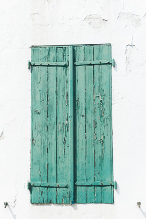 Green Weather Worn Wooden Shutters from the South of France photo