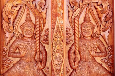 Native Thai style carving, painting on church door in the temple