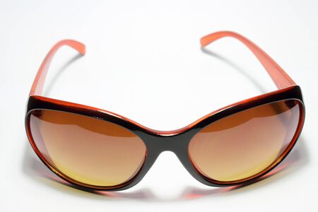 Brown sunglasses isolated on the white background Stock Photo - 13224387