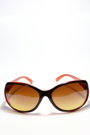 Brown sunglasses isolated on the white background photo