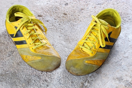 old yellow shoes on concrete Stock Photo - 13368476