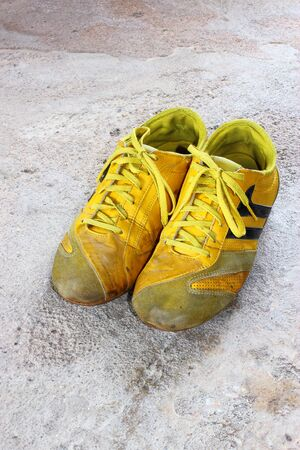 old yellow shoes on concrete Stock Photo - 13368430