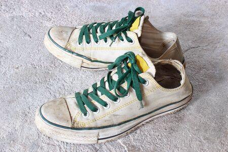 white shoes on concrete background photo