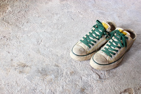white shoes on concrete background photo