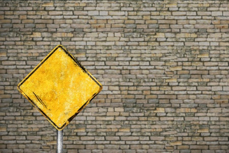 Blank dirty yellow road sign photo