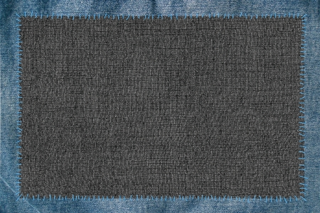 cloth attached by threads to jeans