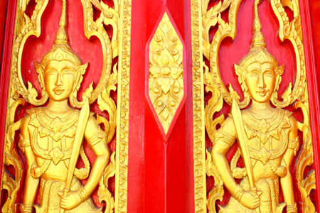 Native Thai style carving, painting on church door in the temple photo