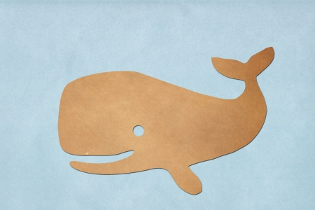 cartoon whale: whale paper on  blue sea