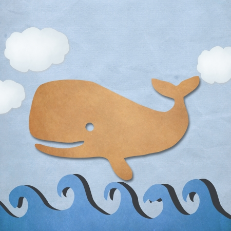 whale paper on  blue sea  photo
