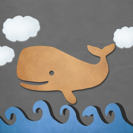 whale paper on  blue sea