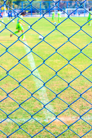 wire fence and football yard photo