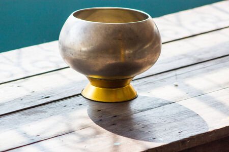 Metal monk alm bowl for donation photo