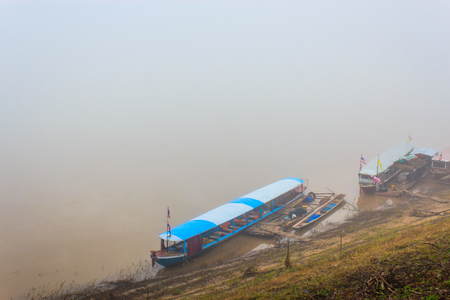 long tailed boat: Boats in fog at Chiangkhan, Thailand