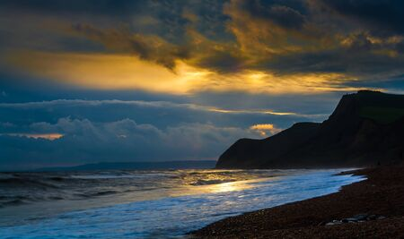 Jurassic coast Dorset uk sunset Stock Photo