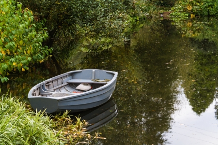 scull boat on a pond in autumn Stock Photo