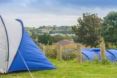 camping site: camping site with caravansa on horizon