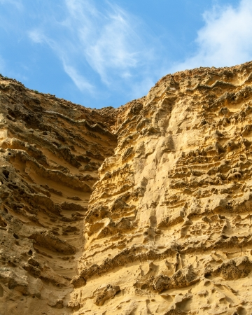 towering sandstone cliff Stock Photo