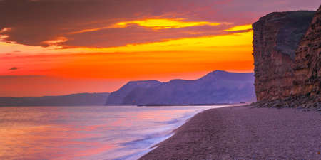 sunset at freshwater beach bridport doset uk Stock Photo
