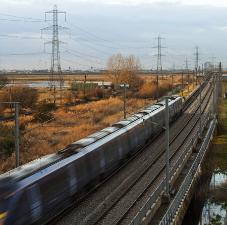 Commuter train belting through Essex Countryside Stock Photo