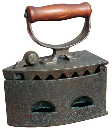 Ferro vecchio sul carbone ardente Archivio Fotografico