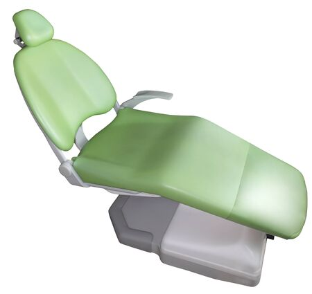 medical cabinet: Green dentist chair on white background