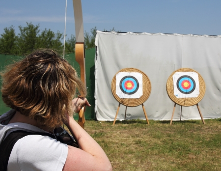 The archer will shoot targets on the lawn Stock Photo