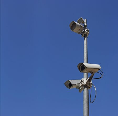 Security camera on blue sky background  photo