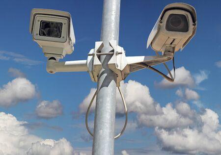 Security camera on blue sky background photo
