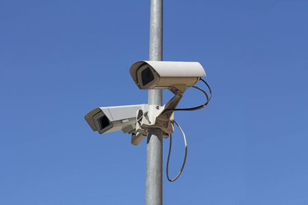Security camera on blue sky background Stock Photo - 14298082