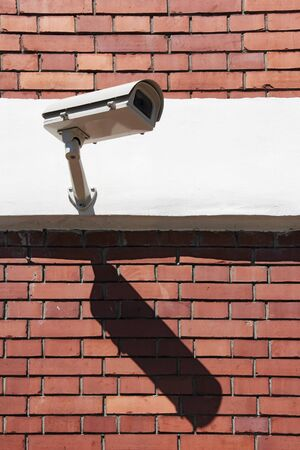 Video Camera Security System on the wall photo