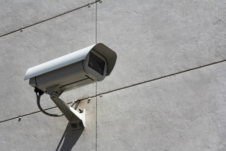 city surveillance: Video Camera Security System on the wall Stock Photo