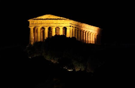 Greek temple of Segesta in Sicily illuminated at night photo