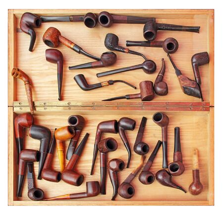 A lot of tobacco pipes in a wooden box