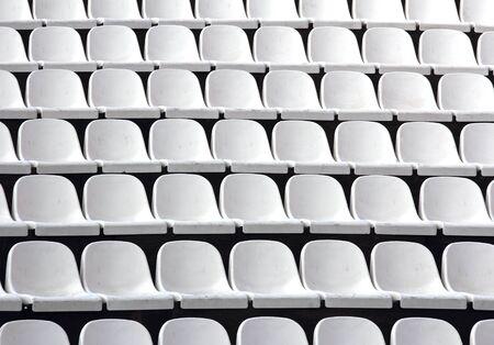 theater audience: Gray plastic chairs at thetribune football stadium