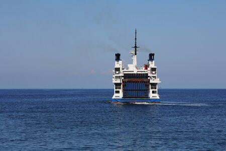 laden: Big white ferry laden cars floating seaward