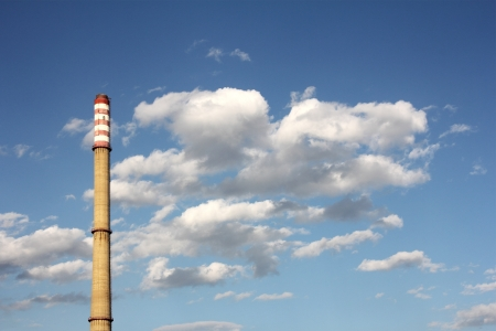 rafinery: An industrial power plant with tall smoke stacks