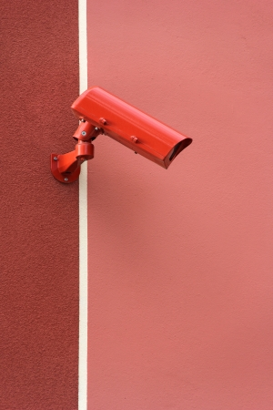 Red video Camera Security System on the wall photo