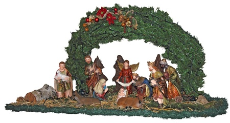 Christmas nativity scene with handmade figurines isolated on white background photo