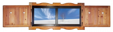 Opened wooden window with a view a tree in the snow, isolated on white background photo