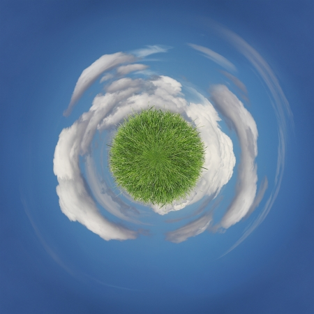 Green planet covered with grass floating in the sky area photo