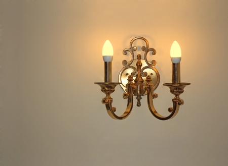 sconce: Wall light of gilded metal with two electric candles