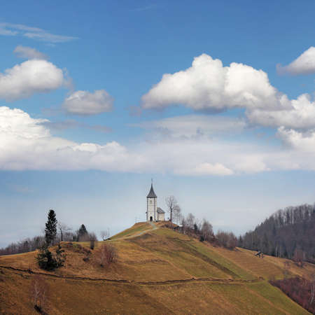 vineyard plain: Little white church on a top hill under blue sky Stock Photo